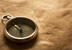 Close-up view of compass on vintage paper Royalty Free Stock Photo