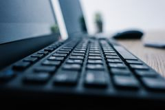 close up view of computer keyboard at table with computer mouse and laptop stock photos