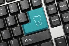 Conceptual keyboard - Blue key with Tooth symbol royalty free stock photos