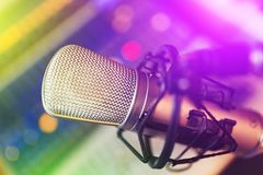Condenser Microphone. Close up view of condenser microphone at colorful lights royalty free stock images