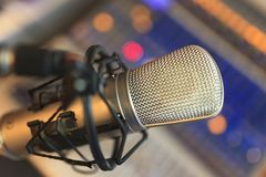 Condenser Microphone. Close up view of condenser microphone at colorful lights royalty free stock photography