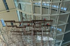 A close up view of a construction site where a new building is being constructed and they have put up rows and rows of scaffolding stock photos