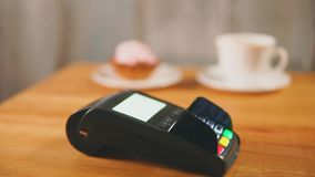 Close up view of contactless payment in store. Vendor put the payment terminal stock footage