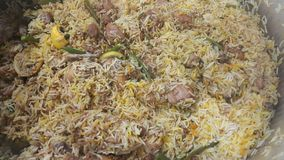 A close up  view of cooked rice chicken biryani made with traditional recipe royalty free stock image