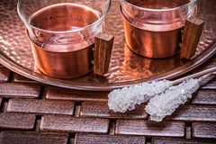 Close up view of coppery tray tea cups sugar Royalty Free Stock Photos