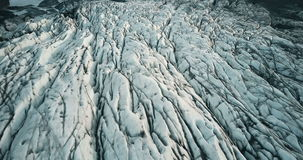 Close-up view of copter flies along the glacier Vatnajokull strip. Aerial view of the tops of the iceberg in Iceland. stock footage