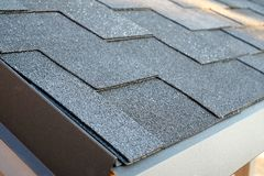 Close up view on corner roof made is asphalt roofing shingles. Royalty Free Stock Photography