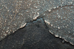 Close-up view of cracked solid natural stone Royalty Free Stock Image