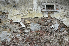 Close up view of crumbling plaster brick wall Royalty Free Stock Images