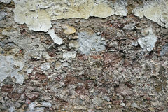 Close up view of crumbling plaster brick wall Royalty Free Stock Photos