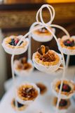 Close-up view of the cupcakes decorated with caramel sauce on the dessert stand. royalty free stock image