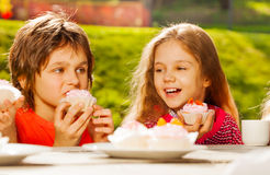 Close up view of cute children with cupcakes royalty free stock image