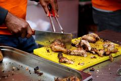 Close up view of cutting grilled chicken by chef stock photos