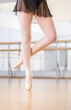 Close up view of dancing legs of ballerina in pointes Stock Photo