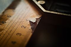 Close up view on L type ruler with label cracking stock images