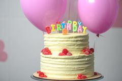 close-up view of delicious birthday cake with number nine stock photography