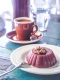 Close-up view of delicious dessert with walnuts, cup of coffee and glass of water. On table Royalty Free Stock Photos