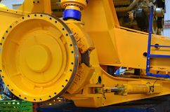 Close-up view of the detail of a large mining truck in the production workshop of the plant. Huge brake disc. Wheel. Truck electri stock images