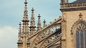 Close-up view of details of facade decoration of gothic cathedral. In sunny weather stock video footage