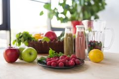 Close up view of detox drinks and healthy food. On table stock photography
