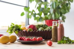 Close up view of detox drinks and healthy food. On table stock images