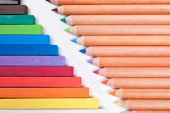 Close up view of different color pencils and chalk pastels isola. View of different color pencils and chalk pastels isolated on the white background. Drawing royalty free stock image