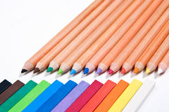 Close up view of different color pencils and chalk pastels isola. View of different color pencils and chalk pastels isolated on the white background. Drawing stock photography