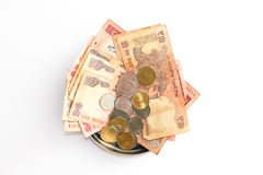 Donation plate with indian banknotes and coins on white background. Close up view of donation plate with indian banknotes and coins on white background stock photos