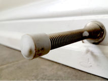 Close-up view of a door stop spring Stock Photos