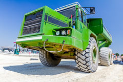Close up view on dumper truck while he is passing over construct Stock Photo
