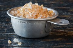 Guar Gum in a Measuring Cup. Close up view of edible guar gum crystals in a measuring cup stock photography