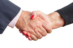 Close up view of an elderly couple shaking hands Stock Photo