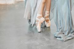 Close up view of elegant ballerina standing on toes in pointes. Close up of a ballet dancer s feet as she dancing in pointe shoes. Ballerina in stage long royalty free stock photo