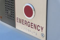 Emergency help button. Close-up view of emergency button for requesting immediate assistance stock images