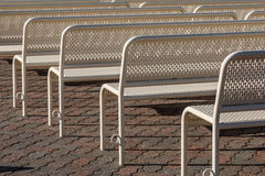 Close-Up View of Empty Benches in Rows from Behind Stock Photography
