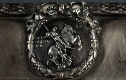 Engraved silver sign. Close up view of engraved silver sign St. George slaying the dragon stock images