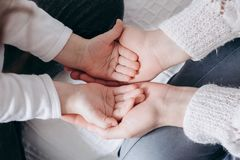Close up view of family holding hands, loving caring mother supporting child, giving psychological support royalty free stock photos