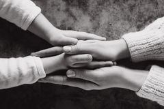 Close up view of family holding hands, loving caring mother supporting child. Helping hand and hope concept. And international day of peace royalty free stock image