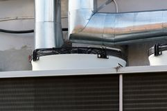 Close-up view of the fans of gray industrial cooling unit for central ventilation system. Close-up view of the fans of industrial cooling unit for central Stock Images