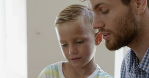 Close up view of father and son talking stock video footage