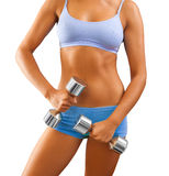 Close up view on female body with dumbbells in hand Royalty Free Stock Images