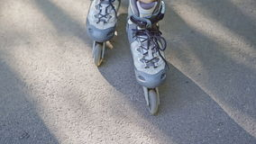 Close-up view of female legs in roller blades stock footage
