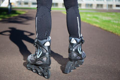 Close up view of female legs in roller blades Stock Images