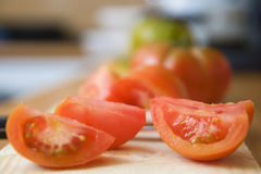 Parties tomatoes in the kitchen Royalty Free Stock Photos