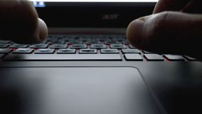 Close-up view fingers tapping keypad of laptop and writing message.  Royalty Free Stock Photo