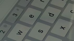Close-up view fingers tapping keypad of tablet and writing message on touch screen.  Royalty Free Stock Image