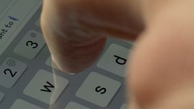 Close-up view fingers tapping keypad of tablet and writing message on touch screen.  Stock Photos