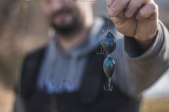 Close-up view - the fisherman put on bait on hooks fishing rods. stock photo