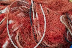 Close up view of fishing net marine background. A Close up view of fishing net marine background stock photos