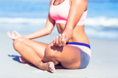 Close up view of fit woman doing yoga beside the sea Stock Image
